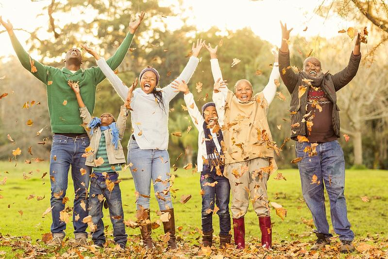 bigstock-Happy-family-throwing-leaves-a-105538037 (1)