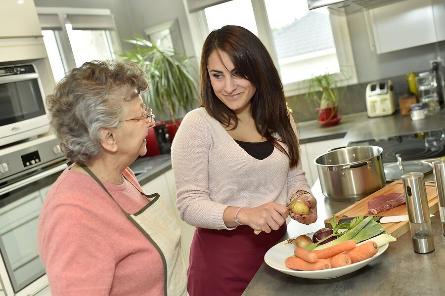 bigstock-Homecare-cooking-dinner-for-el-79646584
