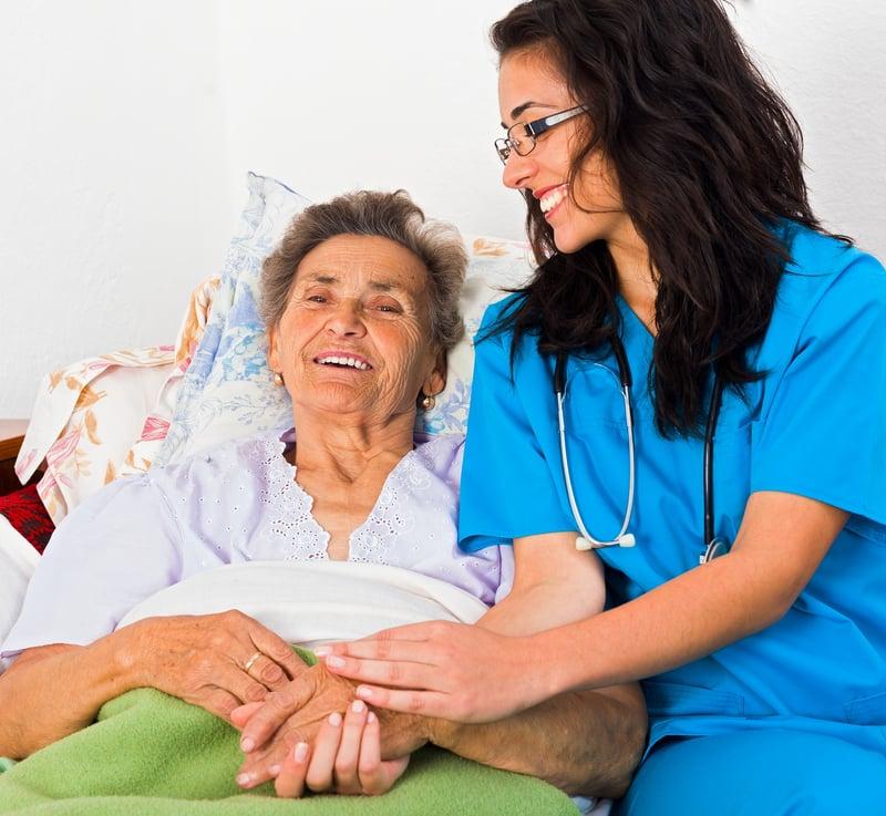 bigstock-Kind-Nurse-With-Elderly-94724273