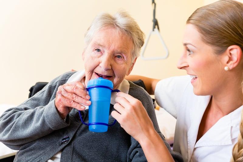 bigstock-Nurse-in-nursing-home-giving-d-82694165