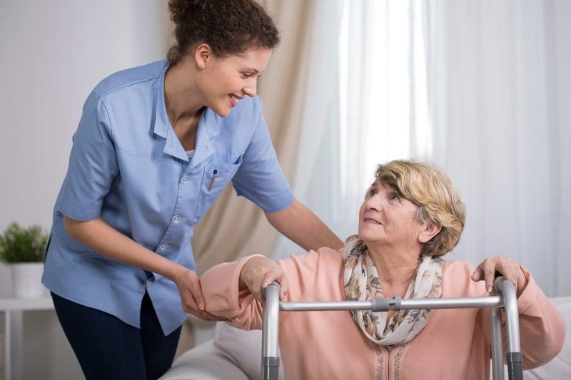 bigstock-Senior-Woman-Using-Walking-Fra-87963893