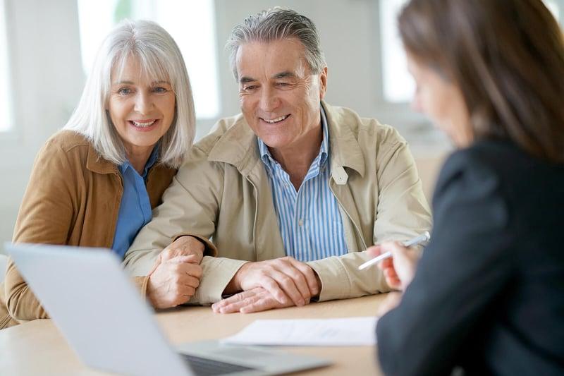 bigstock-Senior-couple-meeting-financia-168933638
