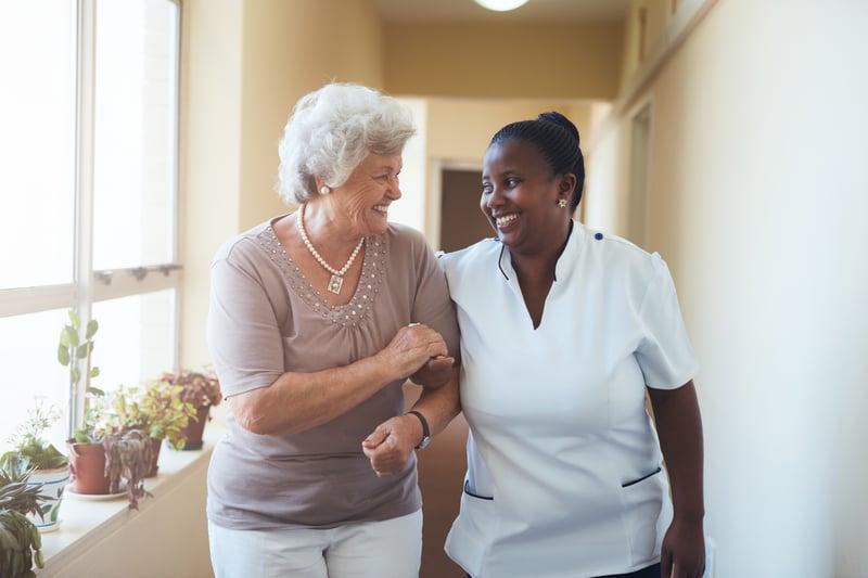 bigstock-Smiling-Home-Caregiver-And-Sen-129899141