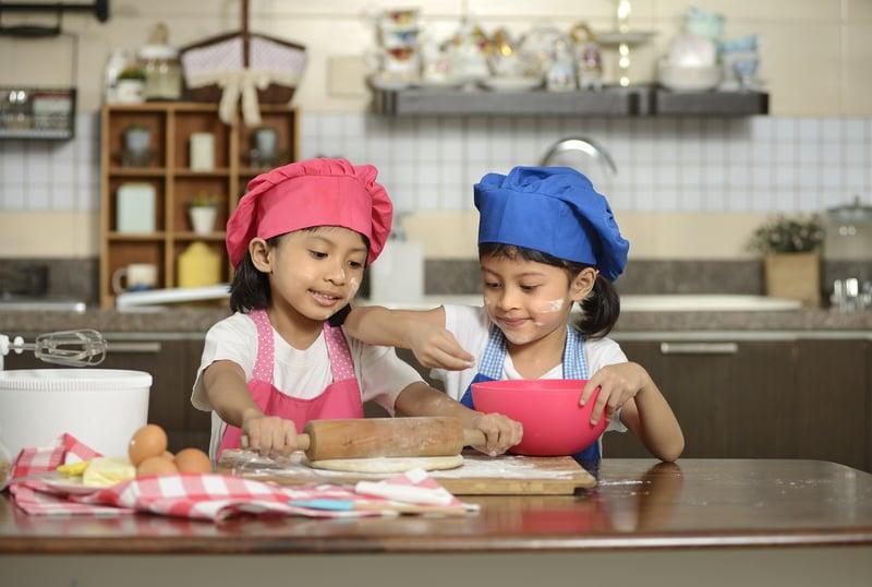 bigstock-Two-Little-Girls-Make-Pizza-87205961