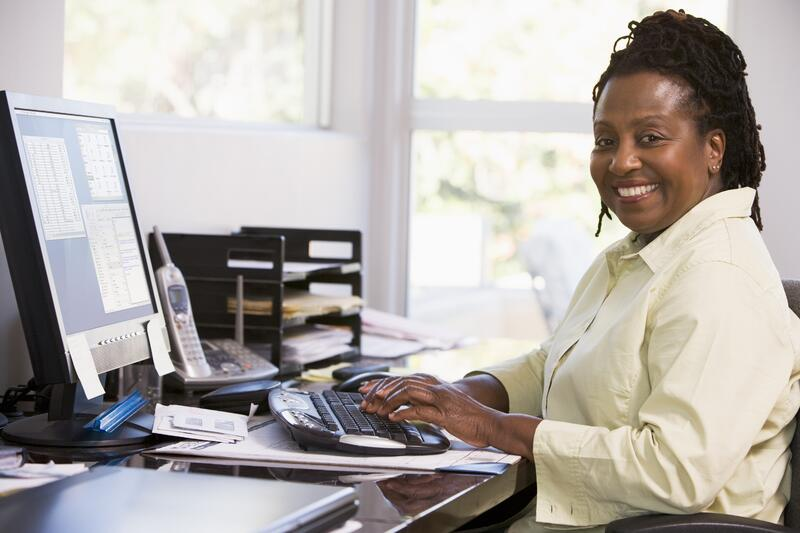 bigstock-Woman-In-Home-Office-Using-Com-4133013